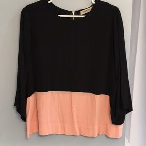 Adorable black and pink blouse.